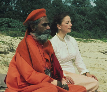 guru meditating and breathing with a student